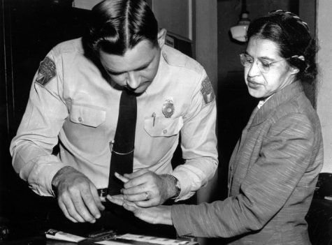 Rosa Parks is fingerprinted by police Lt. D.H. Lackey in Montgomery, Ala., Feb. 22, 1956, two months after refusing to give up her seat on a bus for a white passenger on Dec. 1, 1955. She was arrested with several others who violated segregation laws. Parks