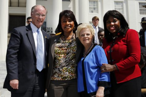 Governor Robert Bentley, Dr. Bernice King, Peggy Wallace Kennedy, and Congresswoman Terri Sewell stand together in front of a crowd of people gathered at the steps of the Alabama State Capitol after a march from Selma, Ala., Wednesday, March 25, 2015, in  Montgomery, Ala.  The daughters of Martin Luther King Jr. and former Alabama Gov. George Wallace, shared a stage on the steps of the Alabama Capitol on Wednesday to mark the 50th anniversary of the 1965 Selma-to-Montgomery voting rights march.   (AP Photo/Butch Dill)