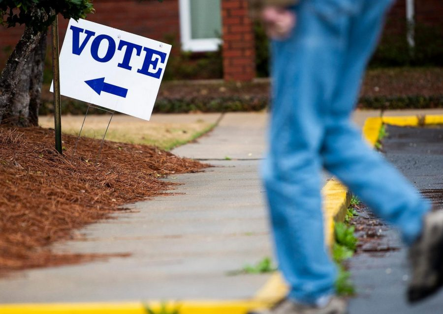 Voters arrive to vote at the Vaughn Park Church of Christ polling place in Montgomery, Ala., on Tuesday March 3, 2020.