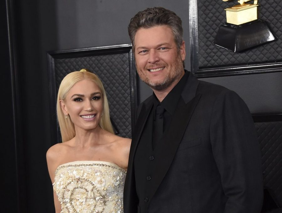 FILE - Gwen Stefani, left, and Blake Shelton arrive at the 62nd annual Grammy Awards in Los Angeles on Jan. 26, 2020. Shelton and Stefani posted a picture on Tuesday announcing their engagement.A representative for Shelton confirmed the couple recently got engaged while in Oklahoma, where Shelton lives. The two stars met as judges on the singing competition show years ago. (Photo by Jordan Strauss/Invision/AP, File)