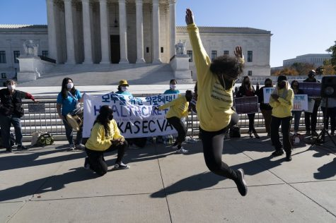 "The dance group ""The Peoples Dancers,"" perform in front of the U.S. Supreme Court as arguments are heard about the Affordable Care Act, Tuesday, Nov. 10, 2020, in Washington. (AP Photo/Alex Brandon)"