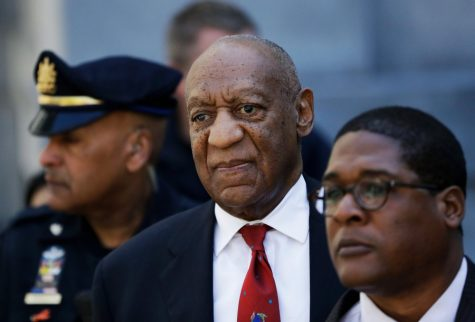 FILE - In this April 26, 2018 file photo, Bill Cosby, center, leaves the the Montgomery County Courthouse in Norristown, Pa., after being convicted of drugging and molesting a woman. The actor has spent more than two years in prison since he was convicted of sexual assault in the first celebrity trial of the #MeToo era. Now the Pennsylvania Supreme Court is set to hear his appeal of the conviction on Tuesday, Dec. 1, 2020. The arguments will focus on the trial judge