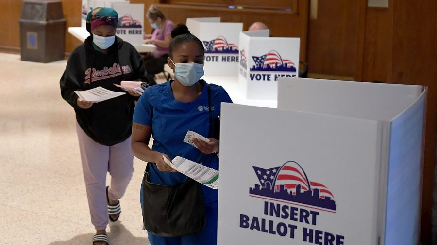 ST LOUIS, MO - AUGUST 04: Voters cast their ballots in Missouri's primary election at Gambrinus Hall in St Louis, Missouri.   Voters will see a host of changes because of the COVID 19 pandemic including less polling places but bigger locations to help with social distancing. (Photo by Michael B. Thomas/Getty Images)