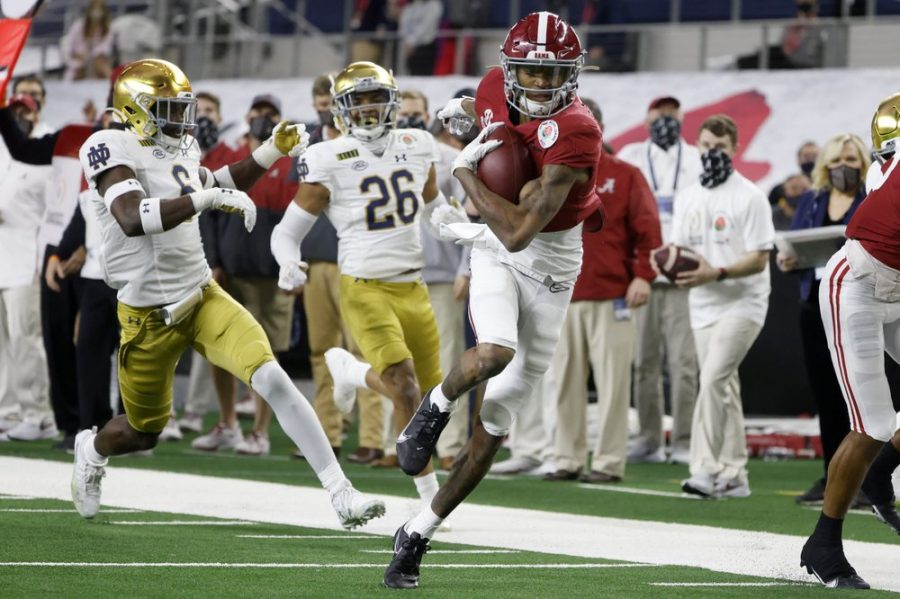 Alabama wide receiver DeVonta Smith (6) gets past Notre Dame linebacker Jeremiah Owusu-Koramoah (6) and cornerback Clarence Lewis (26) on his way to the end zone for a touchdown in the first half of the Rose Bowl NCAA college football game in Arlington, Texas, Friday, Jan. 1, 2021. (AP Photo/Michael Ainsworth)