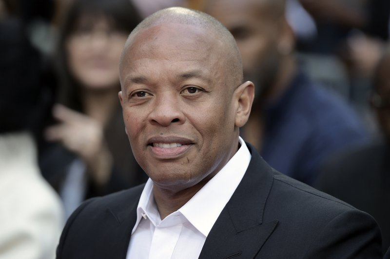 "FILE - Dr. Dre attends a hand and footprint ceremony honoring Quincy Jones on Nov. 27, 2018, in Los Angeles. In a social media post late Tuesday, Jan. 5, 2021, Dr. Dre said he will be ""back home soon"" after the music mogul received medical treatment at a Los Angeles hospital for a reported brain aneurysm. (Photo by Richard Shotwell/Invision/AP, File)"
