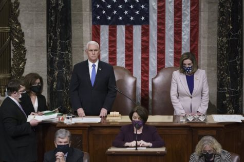 Vice President Mike Pence and Speaker of the House Nancy Pelosi, D-Calif., read the final certification of Electoral College votes cast in November