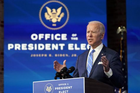 President-elect Joe Biden speaks about the COVID-19 pandemic during an event at The Queen theater, Thursday, Jan. 14, 2021, in Wilmington, Del., as Vice President-elect Kamala Harris listens. (AP Photo/Matt Slocum)