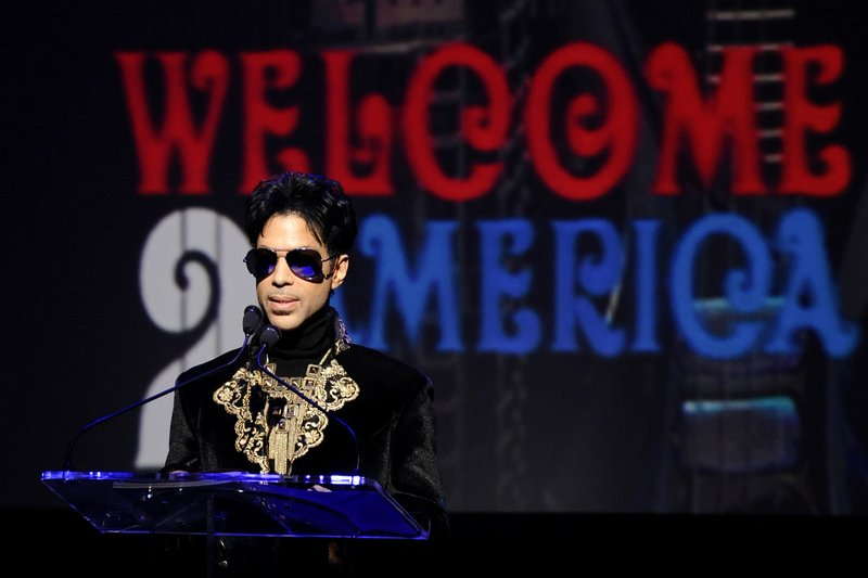 FILE - In this Oct. 14, 2010 file photo, musician Prince holds a news conference at The Apollo Theater announcing his