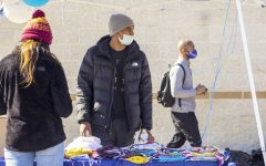 Alumnus sponsors free food and mask giveaway