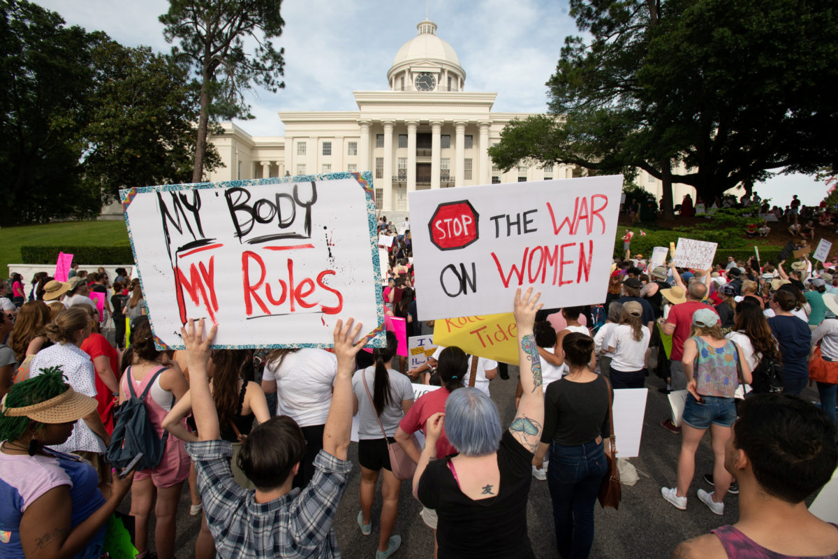 People gather at the Alabama State Capitol during the March for Reproductive Freedom against the state's new abortion law, the Alabama Human Life Protection Act, in Montgomery, Alabama, U.S. May 19, 2019. REUTERS/Michael Spooneybarger