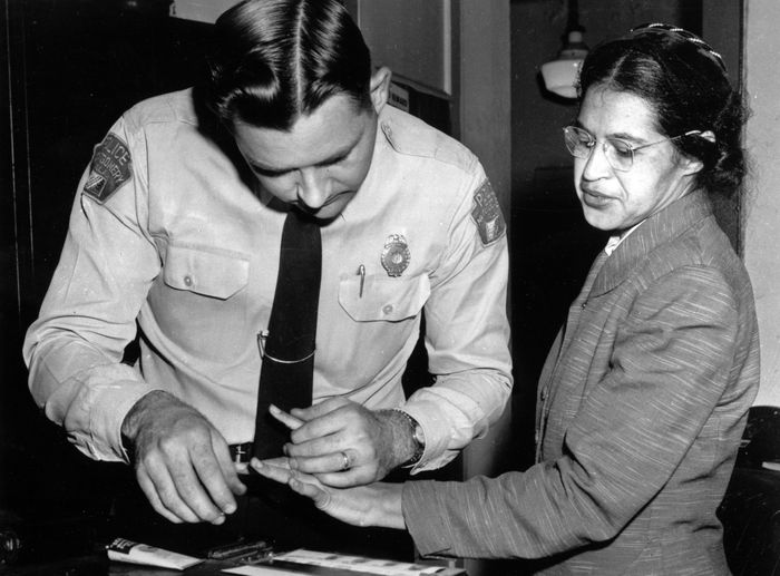 Rosa Parks is fingerprinted by police Lt. D.H. Lackey in Montgomery, Ala., Feb. 22, 1956, two months after refusing to give up her seat on a bus for a white passenger on Dec. 1, 1955. She was arrested with several others who violated segregation laws. Parks' refusal to give up her seat led to a boycott of buses by blacks in Dec. 1955, a tactic organized by the Rev. Dr. Martin Luther King Jr., which ended after the U.S. Supreme Court deemed that all segregation was unlawful,Dec. 20, 1956. (AP Photo/Gene Herrick)
