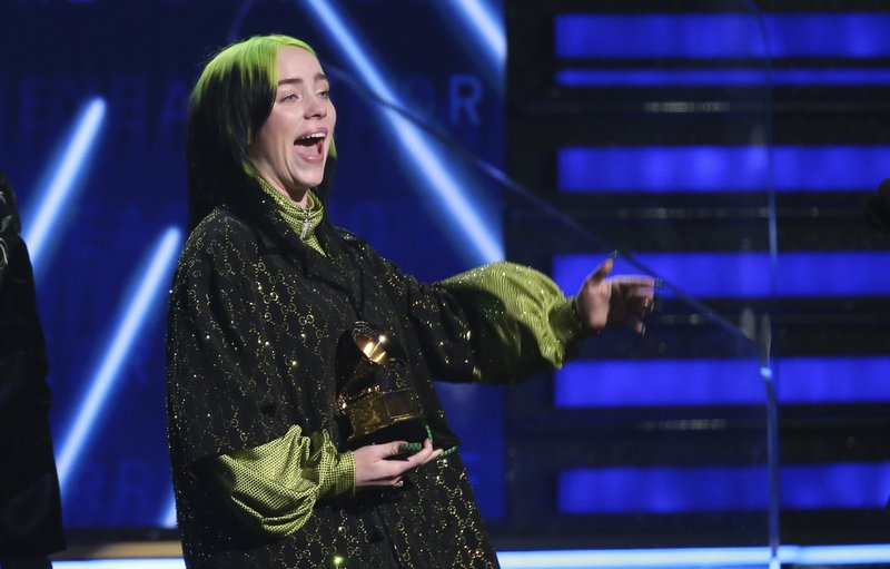 "Billie Eilish accepts the award for record of the year for ""Bad Guy"" at the 62nd annual Grammy Awards on Sunday, Jan. 26, 2020, in Los Angeles."