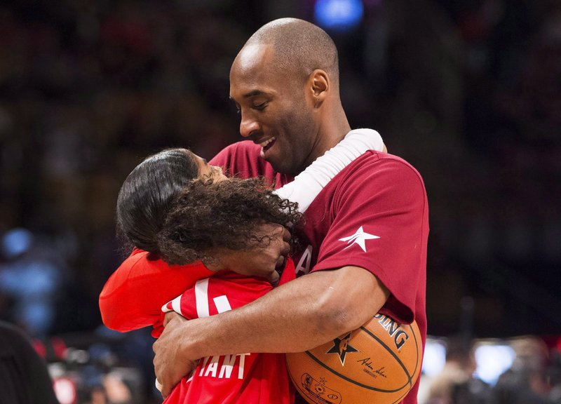 In this Feb. 14, 2016, file photo, Los Angeles Lakers Kobe Bryant (24) hugs his daughter Gianna on the court in warm-ups before first half NBA All-Star Game basketball action in Toronto. Bryant, his 13-year-old daughter, Gianna, and several others are dead after their helicopter went down in Southern California on Sunday, Jan. 26, 2020.