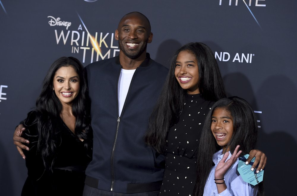 In this April 13, 2016, file photo, Los Angeles Lakers' Kobe Bryant poses for pictures with his wife Vanessa, left, and daughters Natalia, second from right, and Gianna as they stand on the court after an NBA basketball game against the Utah Jazz, in Los Angeles. Bryant, the 18-time NBA All-Star who won five championships and became one of the greatest basketball players of his generation during a 20-year career with the Los Angeles Lakers, died in a helicopter crash Sunday, Jan. 26, 2020.