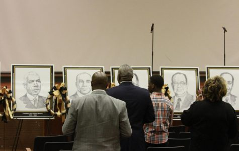 President Quinton T. Ross and others, stand to honor former University Presidents,
