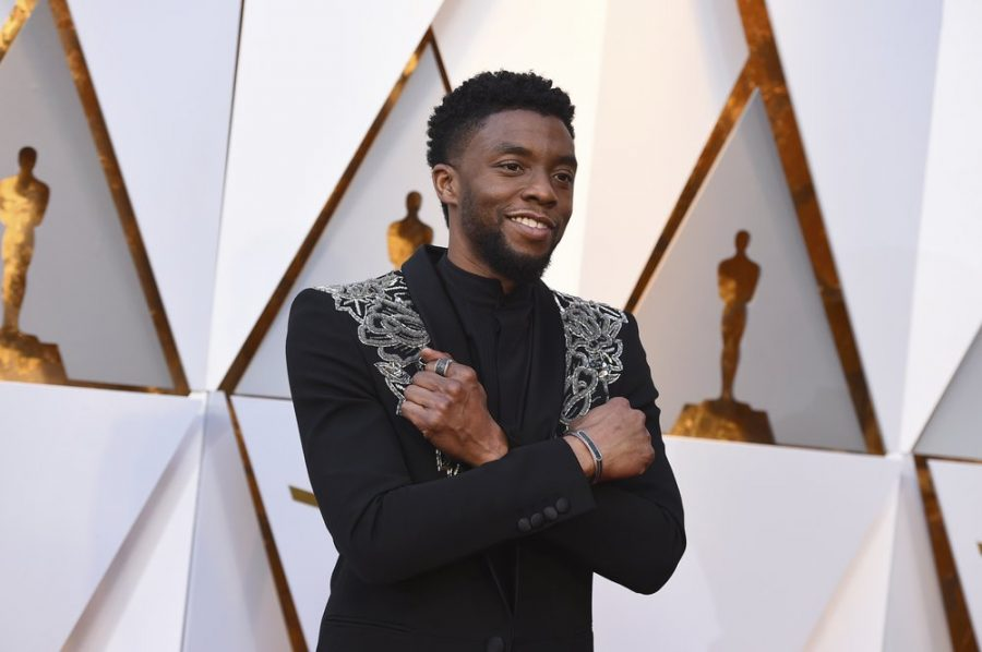 FILE - In this March 4, 2018 file photo, Chadwick Boseman arrives at the Oscars at the Dolby Theatre in Los Angeles. Actor Chadwick Boseman, who played Black icons Jackie Robinson and James Brown before finding fame as the regal Black Panther in the Marvel cinematic universe, has died of cancer. His representative says Boseman died Friday, Aug. 28, 2020 in Los Angeles after a four-year battle with colon cancer. He was 43. (Photo by Jordan Strauss/Invision/AP)