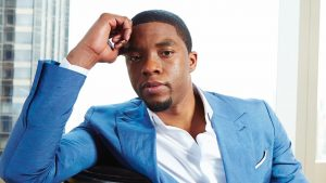 FILE - This July 21, 2014 file photo shows actor Chadwick Boseman posing for a portrait in New York. Boseman, who played Black icons Jackie Robinson and James Brown before finding fame as the regal Black Panther in the Marvel cinematic universe, has died of cancer. His representative says Boseman died Friday, Aug. 28, 2020 in Los Angeles after a four-year battle with colon cancer. He was 43. (Photo by Dan Hallman/Invision/AP, File)