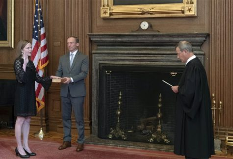 In this image provided by the Collection of the Supreme Court of the United States, Chief Justice John G. Roberts, Jr., right, administers the Judicial Oath to Judge Amy Coney Barrett in the East Conference Room of the Supreme Court Building, Tuesday, Oct. 27, 2020, in Washington as Judge Barrett