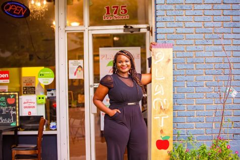 Alumna Quebe Merritt Bradford, Ph.D., stands outside of the relatively new business, Plant Bae, that she and her husband opened located at 123 Lee Street in Montgomery.  She credits every day and every course in her college experience for preparing her for a career full of advancements and achievements.