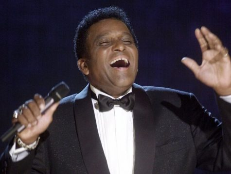 CORRECTS FIRST NAME TO CHARLEY, INSTEAD OF CHARLIE FILE - In this Oct. 4, 2000, file photo, Charley Pride performs during his induction into the Country Music Hall of Fame at the Country Music Association Awards show at the Grand Ole Opry House in Nashville, Tenn. Pride, the son of sharecroppers in Mississippi and became one of country music's biggest stars and the first Black member of the Country Music Hall of Fame, has died at age 86. Pride died Saturday, Dec. 12, 2020, in Dallas of complications from Covid-19, according to Jeremy Westby of the public relations firm 2911 Media. (AP Photo/Charlie Neibergall, File)