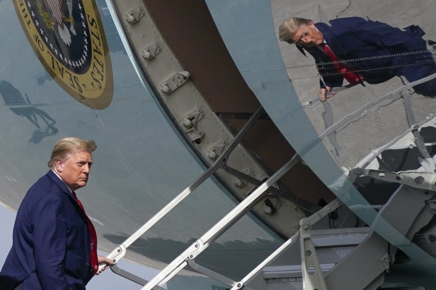In this Dec. 31, 2020, file photo President Donald Trump boards Air Force One at Palm Beach International Airport in West Palm Beach, Fla. (AP Photo/Patrick Semansky, File)