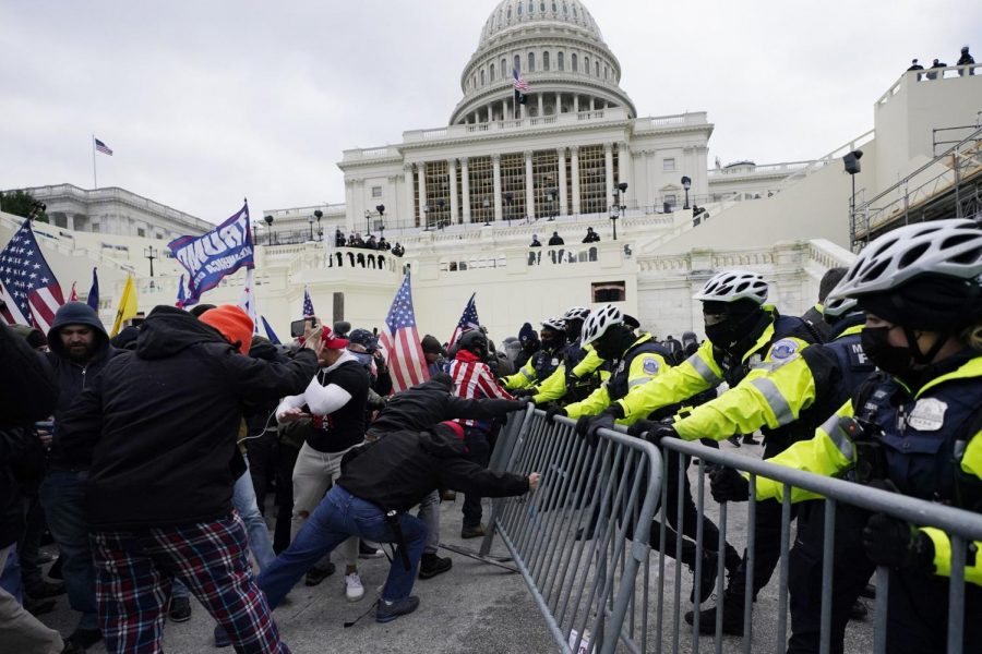 Trump supporters try to break through a police barrier, Wednesday, Jan. 6, 2021, at the Capitol in Washington. (AP Photo/Julio Cortez)