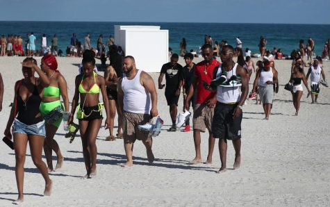 Beachgoers leave South Beach on Sunday, March 15, 2020.   With four deaths, Florida was already on the front lines of the coronavirus crisis (Joe Raedle/Getty Images via CNN).