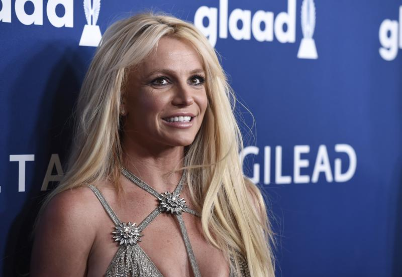 FILE - Britney Spears arrives at the 29th annual GLAAD Media Awards on April 12, 2018, in Beverly Hills, Calif. Spears has asked to address the court to talk about the conservatorship that controls her life and finances. A Los Angeles judge on Tuesday, April 27, 2021, set a June hearing to hear from Spears. (Photo by Chris Pizzello/Invision/AP, File)