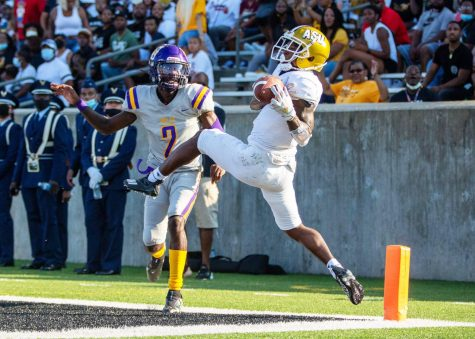 Alabama State University's wide receiver Keron Jones (6) nearly catches an overthrown pass to the end zone as Miles College's defensive back Rodney Coleman, Jr. (2) watches on September 04, 2021.