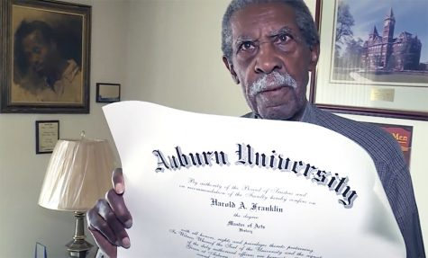 Harold A. Franklin displays his master of arts diploma that he received from Auburn University after waiting for 54 years.