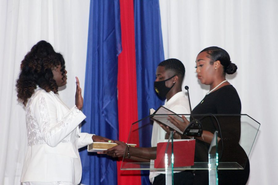 Student Government Association Chief Justice Alexis McDaniel administers the Oath of Office to Student Body President Gem Richardson during the formal swearing in of the executive and legislative officers that was held on Aug. 30 in Abernathy Hall.