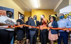 Whataburger rep, trustee, university administrators, staff and faculty cut the ribbon during the opening of the Resource Room