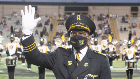 After 20 years of serving as the band director for Alabama State University, James B. Oliver, Ed.D., waves to the crowd as they express their appreciation for the impact that he has made with hundreds of students since returning to his alma mater to lead the band.